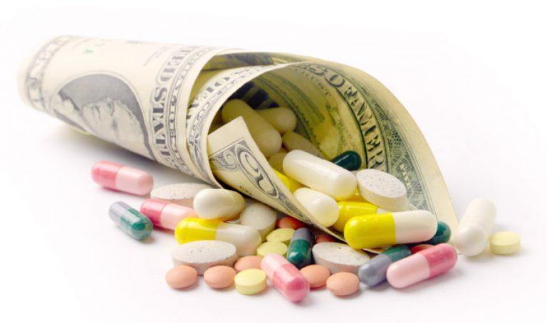 Money Pills shutterstock_233987695